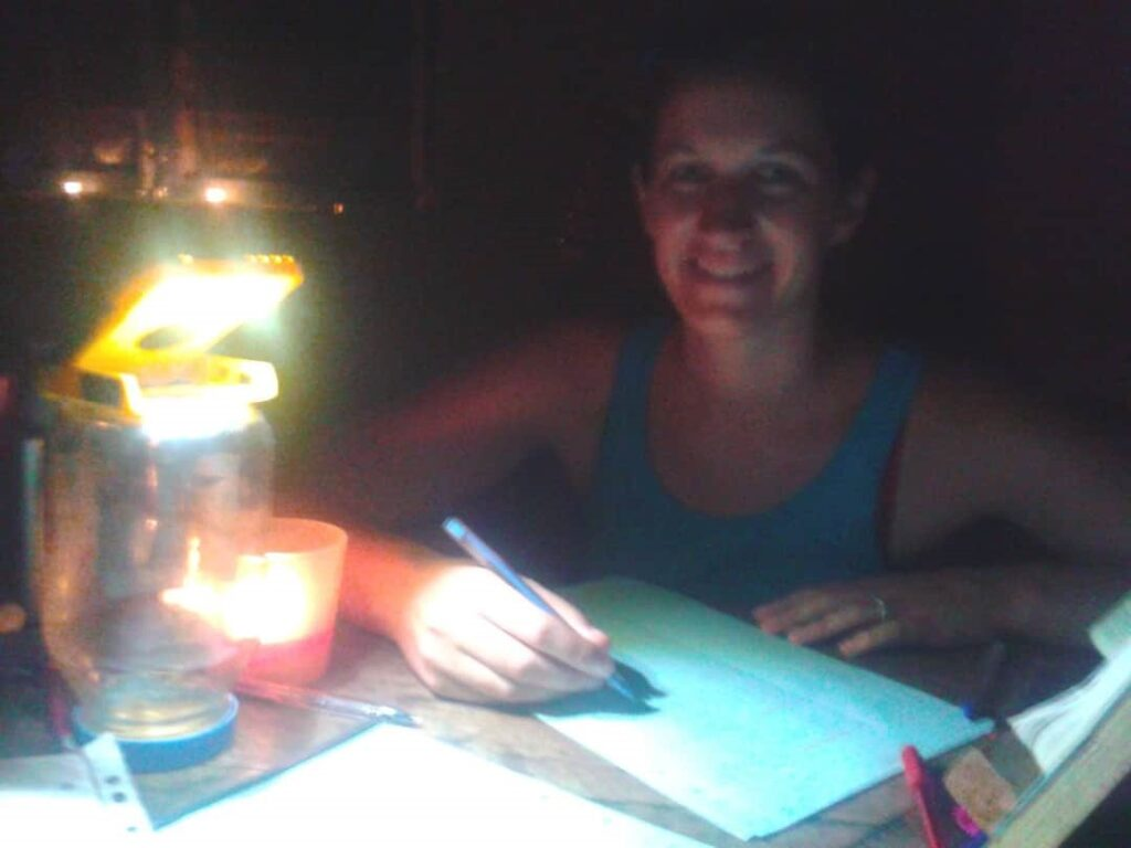 Working by lamplight during a power cut in Togo